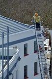 Firefighter on a high Hydraulic Crane Platform Stock Image