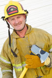 Firefighter Holding Axe Stock Image