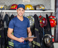 Firefighter Holding Clipboard At Fire Station Royalty Free Stock Photos