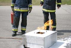 Firefighter holding extinguisher Stock Image