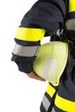 Firefighter holding helmet isolated on white. Firefighter holding helmet isolated on the white Stock Photo