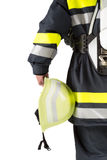 Firefighter holding helmet isolated on white Royalty Free Stock Photos