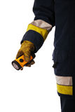 Firefighter holding torch Royalty Free Stock Image