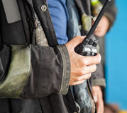 Firefighter Holding Walkie Talkie. Midsection of firefighter holding walkie talkie at fire station Stock Photos