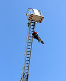 Firefighter hung the rope climbing in the firehouse Royalty Free Stock Image