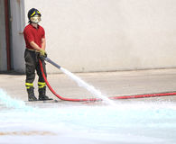 Firefighter with the hydrant mind tests the flow of water during Stock Photography