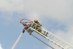 Firefighter on a ladder Stock Photography