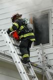 Firefighter on Ladder Stock Photo