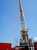 Firefighter Ladder Climb. Firefighter begins his climb on an aerial ladder Royalty Free Stock Photography