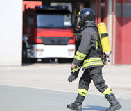 Firefighter with large oxygen cylinder and automatic respirator Stock Photography