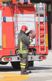 Firefighter lifted the hose after switching off the fire Royalty Free Stock Photo