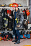 Firefighter Looking At Walkie Talkie In Fire Royalty Free Stock Photography
