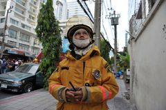 A Firefighter Looks on at Blaze in an Office Block. A firefighter looks on at blaze at Fico Building on Asoke Road in the city centre on Mar 5, 2012 in Bangkok Royalty Free Stock Images