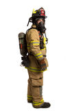Firefighter with mask and airpack protective suit Stock Image