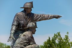 Firefighter Memorial Statue Kansas City. Firefighter Memorial Bronze Statue located near downtown Kansas City Missouri in memory of our lost firefighters stock image