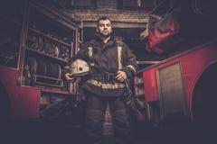 Firefighter near truck Stock Photography