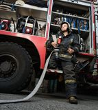 Firefighter near truck Royalty Free Stock Image