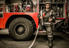 Firefighter near truck Royalty Free Stock Photos