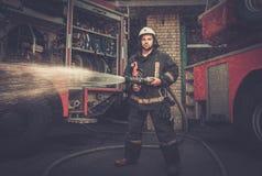 Firefighter near truck Stock Photo