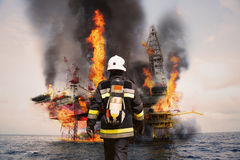 Firefighter in oil and gas industry with mission successful for protect with emergency case or worst case, Personal protective Stock Photo