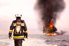 Firefighter in oil and gas industry with mission successful for protect with emergency case or worst case, Personal protective Royalty Free Stock Photos