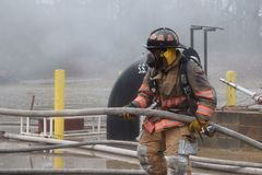 Firefighter, Personal Protective Equipment, Water, Profession Royalty Free Stock Images