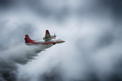 Firefighter plane dropping water Royalty Free Stock Image