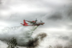 Firefighter plane dropping water Stock Photography
