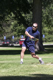 Firefighter playing with flying disc. Fort Collins firefighter working hard to stay in shape Royalty Free Stock Images