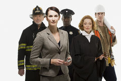 Firefighter police officer judge construction worker and businesswoman Royalty Free Stock Images