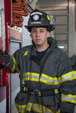 Firefighter Portrait In Front of Fire Truck Stock Photo