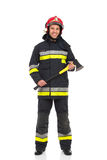 Firefighter posing with axe. Royalty Free Stock Image