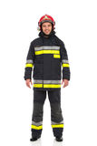 Firefighter posing, front view. Royalty Free Stock Photos