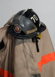 Firefighter Protective Clothing. View of protective clothing worn by a firefighter, particularly a Nomex jacket and hard hat stock photography