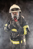Firefighter in protective gear Royalty Free Stock Images