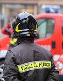 Firefighter with protective helmet and the word VIGILI DEL FUOCO Royalty Free Stock Photography