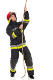 Firefighter pulling a rope Stock Images