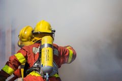 Firefighter and rescue team surround with smoke and dust Stock Photography