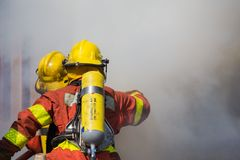 Firefighter and rescue team surround with smoke and dust Royalty Free Stock Image