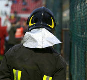 Firefighter with riot helmet for the security service Stock Photography