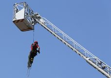 Firefighter with the rope climbing in firehouse Royalty Free Stock Photo