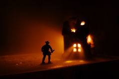 Firefighter run onto the burning Stock Photo