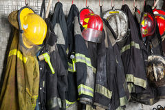 Firefighter's Gear Hanging At Fire Station. Firefighter suits and helmets hanging at fire station Royalty Free Stock Image