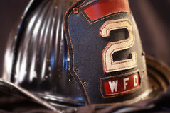 Firefighter's hat 02. Close up of a fireman''s helmet hat royalty free stock photos