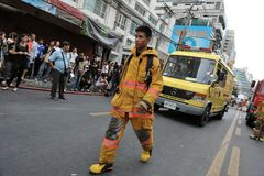 A Firefighter at the Scene of an Office Fire. A firefighter walks along Asoke Road while a blaze at Fico Building is brought under control on March 5, 2012 in Royalty Free Stock Photography