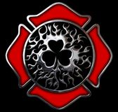 Firefighter Shamrock chromed shield. This is a Firefighter Shamrock chromed shield design with clipping path for easy editing Royalty Free Stock Images