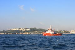 Firefighter Ship. A firefighter ship convoys the oil products tanker MINERVA DOXA on August 6, 2012 in Istanbul. Usually the captain of the pilot ship takes the Royalty Free Stock Photo