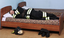Firefighter sleeps Royalty Free Stock Images