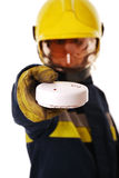 Firefighter with smoke detector Stock Image