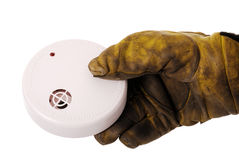 Firefighter with smoke detector Royalty Free Stock Photography